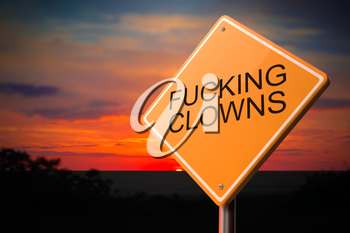 Fucking Clowns on Warning Road Sign on Sunset Sky Background.