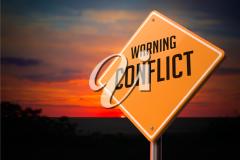 Conflict on Warning Road Sign on Sunset Sky Background.
