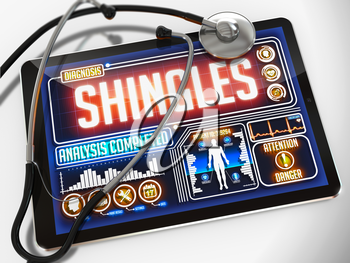 Medical Tablet with the Diagnosis of Shingles on the Display and a Black Stethoscope on White Background.