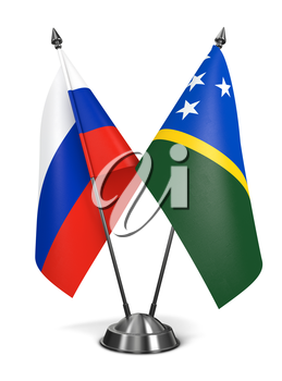 Russia and Solomon Islands - Miniature Flags Isolated on White Background.