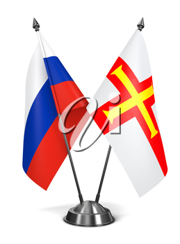 Royalty Free Clipart Image of Russia and Guernsey Miniature Flags