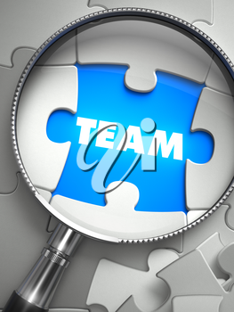 Team - Word on the Place of Missing Puzzle Piece through Magnifier. Selective Focus.