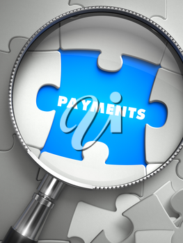 Payments - Word on the Place of Missing Puzzle Piece through Magnifier. Selective Focus.