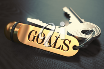 Goals - Bunch of Keys with Text on Golden Keychain. Black Wooden Background. Closeup View with Selective Focus. 3D Illustration. Toned Image.