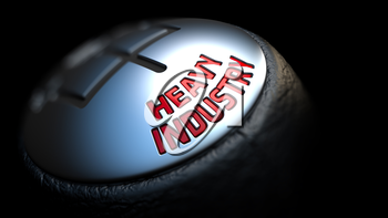 Heavy Industry. Shift Knob with Red Text on Black Background. Close Up View. Selective Focus. 3D Render.