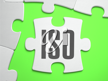 ISO - International Organization for Standardization - Jigsaw Puzzle with Missing Pieces. Bright Green Background. Close-up. 3d Illustration.