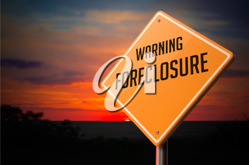 Foreclosure on Warning Road Sign on Sunset Sky Background.