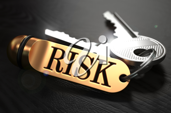 Keys with Word Risk on Golden Label over Black Wooden Background. Closeup View, Selective Focus, 3D Render.