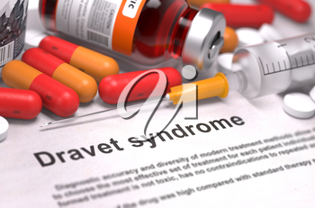 Dravet Syndrome - Printed Diagnosis with Blurred Text. On Background of Medicaments Composition - Red Pills, Injections and Syringe.