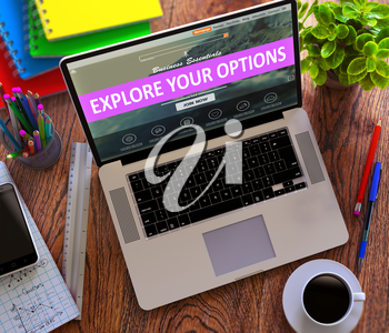 Explore Your Options Concept. Modern Laptop and Different Office Supply on Wooden Desktop background.