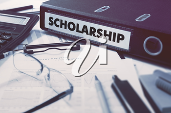 Scholarship - Office Folder on Background of Working Table with Stationery, Glasses, Reports. Business Concept on Blurred Background. Toned Image.