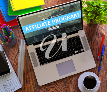 Affiliate Program Concept. Modern Laptop and Different Office Supply on Wooden Desktop background.