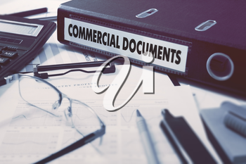 Commercial Documents - Ring Binder on Office Desktop with Office Supplies. Business Concept on Blurred Background. Toned Illustration.