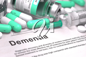 Dementia - Printed Diagnosis with Blurred Text. On Background of Medicaments Composition - Mint Green Pills, Injections and Syringe.