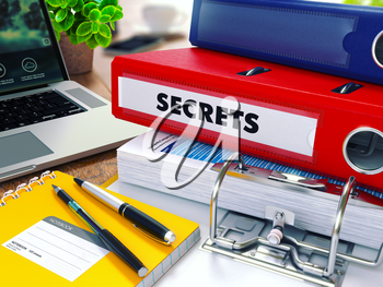 Secrets - Red Ring Binder on Office Desktop with Office Supplies and Modern Laptop. Business Concept on Blurred Background. Toned Illustration.