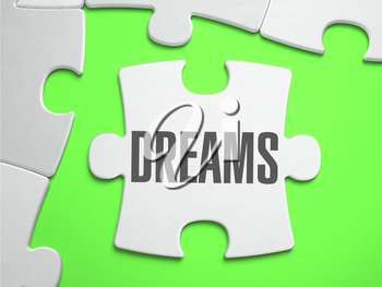Dreams - Jigsaw Puzzle with Missing Pieces. Bright Green Background. Close-up. 3d Illustration.