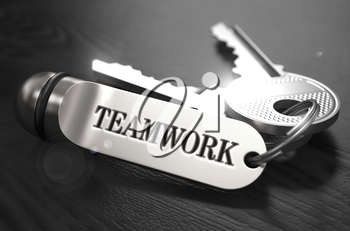 Teamwork Concept. Keys with Keyring on Black Wooden Table. Closeup View, Selective Focus, 3D Render. Black and White Image.