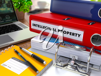 Red Ring Binder with Inscription Intellectual Property on Background of Working Table with Office Supplies, Laptop, Reports. Toned Illustration. Business Concept on Blurred Background.
