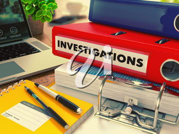 Red Office Folder with Inscription Investigations on Office Desktop with Office Supplies and Modern Laptop. Business Concept on Blurred Background. Toned Image.