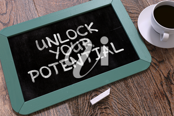 Hand Drawn Unlock Your Potential Concept  on Small Blue Chalkboard. Business Background. Top View.