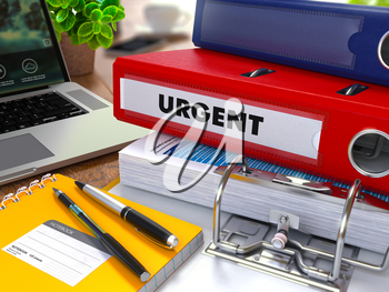Red Ring Binder with Inscription Urgent on Background of Working Table with Office Supplies, Laptop, Reports. Toned Illustration. Business Concept on Blurred Background.