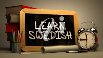 Learn Swedish - Chalkboard with Hand Drawn Text, Stack of Books, Alarm Clock and Rolls of Paper on Blurred Background. Toned Image. Inspirational Quote.