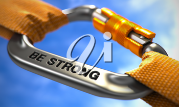 Be Strong. Motivational Quote on Chrome Carabine with a Orange Ropes. Selective Focus.