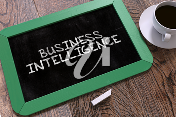 Business Intelligence Handwritten on Green Chalkboard. Business Concept. Composition with Chalkboard and Cup of Coffee. Top View Image.