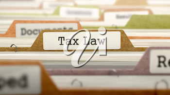 Tax Law - Folder Register Name in Directory. Colored, Blurred Image. Closeup View.