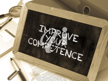 Hand Drawn Inspirational Quote - Improve Your Competence - on Chalkboard. Blurred Background. Toned Image.