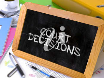 Handwritten Court Decisions on a Chalkboard. Composition with Chalkboard and Ring Binders, Office Supplies, Reports on Blurred Background. Toned Image.