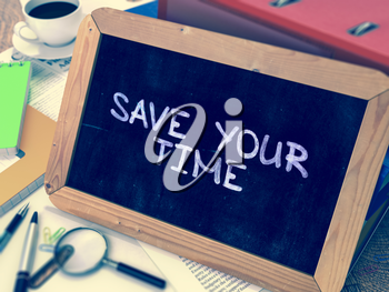 Save Your Time - Chalkboard with Hand Drawn Text, Stack of Office Folders, Stationery, Reports on Blurred Background. Toned Image.