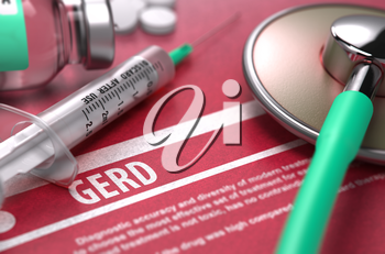 GERD - Printed Diagnosis on Red Background and Medical Composition - Stethoscope, Pills and Syringe. Medical Concept. Blurred Image.