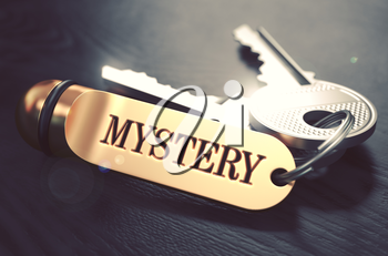 Keys with Word Mystery on Golden Label over Black Wooden Background. Closeup View, Selective Focus, 3D Render. Toned Image.