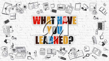 What Have You Learned. Multicolor Question on White Brick Wall with Doodle Icons Around. Modern Style Illustration with Doodle Design Elements. What Have You Learned on White Brickwall Background.