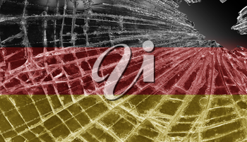 Broken ice or glass with a flag pattern, isolated, Germany