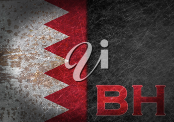 Old rusty metal sign with a flag and country abbreviation - Bahrain