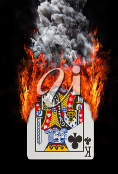 Playing card with fire and smoke, isolated on white - King of clubs