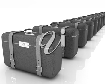 Brown traveler's suitcases on a white background