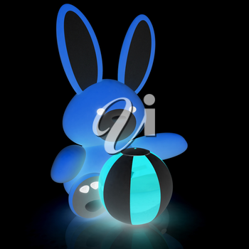 soft toy hare and colorful aquatic ball on a black background