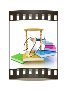 Hourglass and books on a white background. The film strip