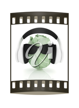 Green cabbage with sun glass and headphones front face on a white background. The film strip