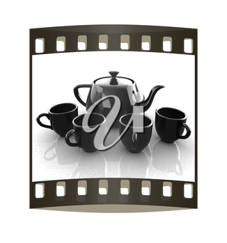 black teapot and cups. The film strip