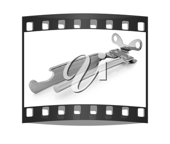 A can opener isolated against a white background (CLIPPING PATH). The film strip