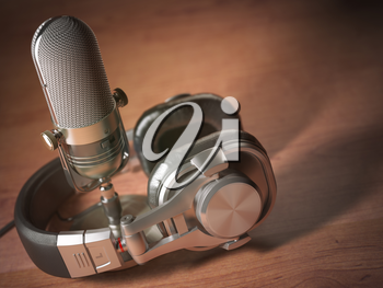 Microphone and headphones on the wooden table. Retro vintage style background. Radio concept. 3d illustration