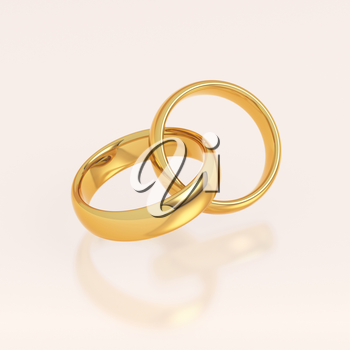 Two golden wedding rings on pink background. Love and marriage concept.