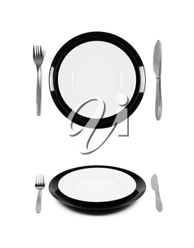 Black and white plates with fork and knife. 2 different views. Isolated on white background. Two different view angles. Graphic design element for poster, menu, restaurant or cafe flyer.