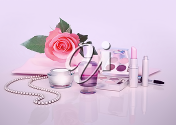 Cosmetics set on lilac background.