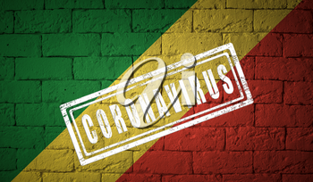 Flag of the Republic o the Congo on brick wall texture. stamped of Coronavirus. Corona virus concept. On the verge of a COVID-19 or 2019-nCoV Pandemic. Novel Chinese Coronavirus outbreak