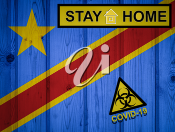 Flag of the Democratic Republic of the Congo in original proportions. Quarantine and isolation - Stay at home. flag with biohazard symbol and inscription COVID-19.